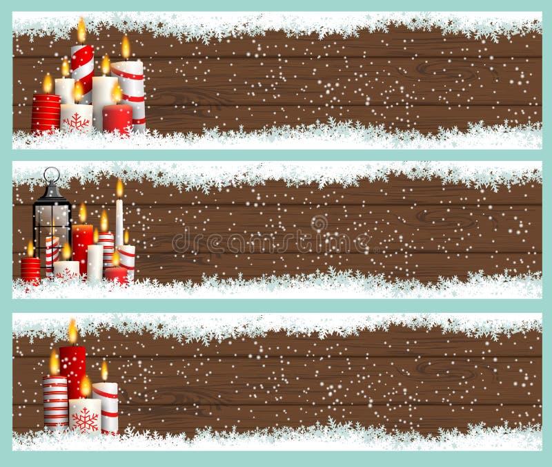 Três bandeiras do Natal com velas e flocos de neve ilustração stock