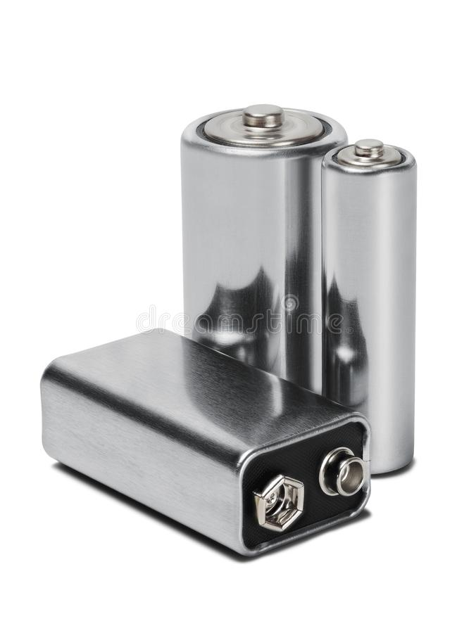 Três baterias AAA, AA e PP3 no branco isolaram o fundo Conceito da energia renovável e das fontes de corrente elétrica Teste padr foto de stock royalty free