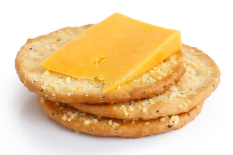 Três biscoitos dourados do queijo no branco fotos de stock