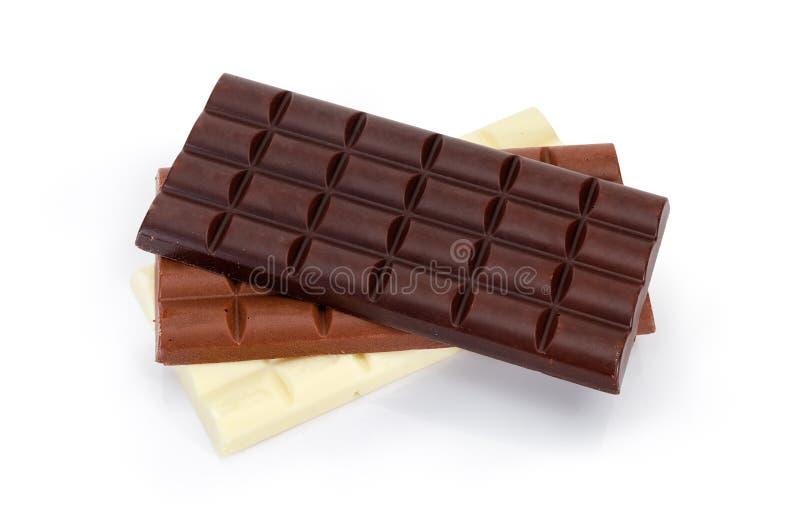 Três blocos da obscuridade, do leite e do chocolate ventilado branco imagem de stock