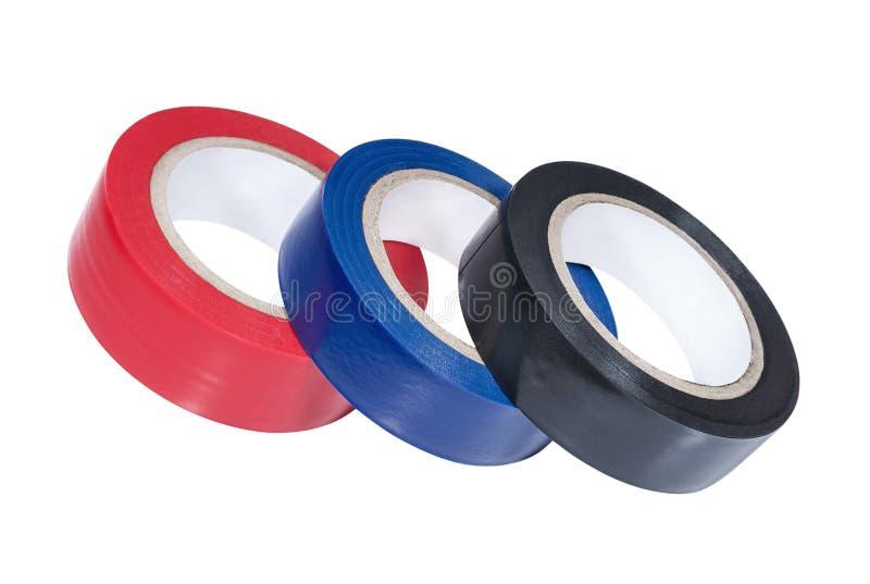 Três bobinas da fita adesiva colorido imagens de stock
