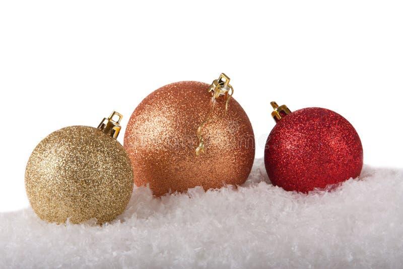 Três bolas brilhantes do Natal imagem de stock