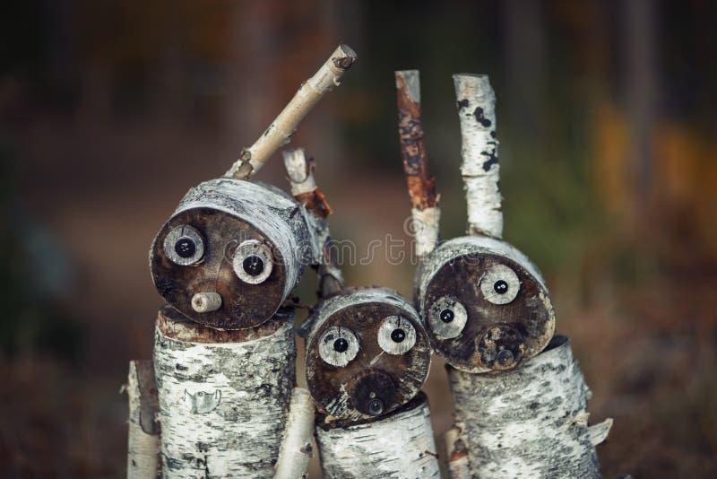 Três brinquedos de madeira retrato do centeio de madeira dos cotoes fotos de stock royalty free