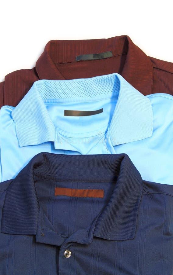 Três camisas do golfe imagens de stock