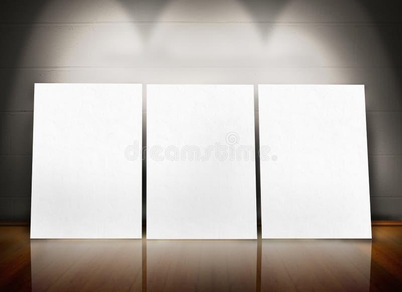 Três cartazes que estão na linha imagem de stock