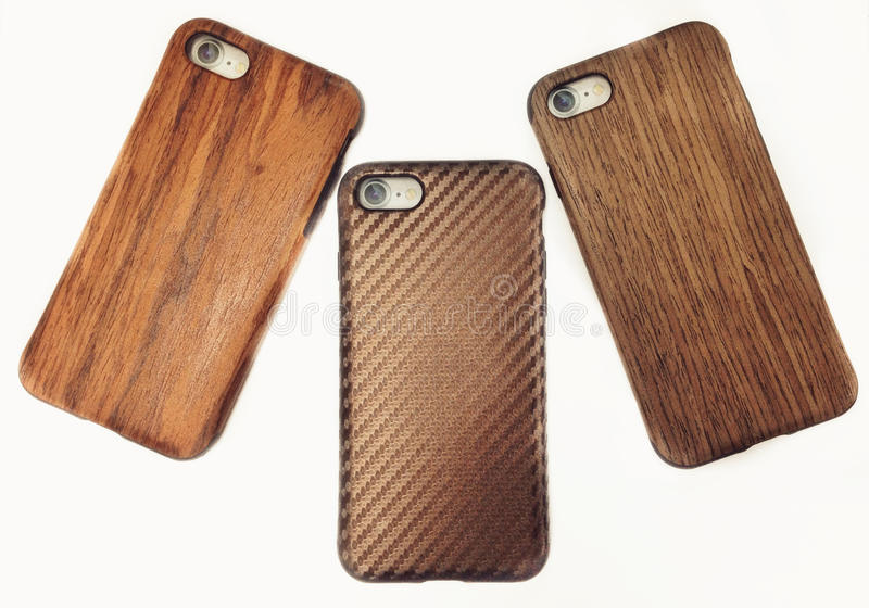 Três casos de madeira do iphone fotos de stock