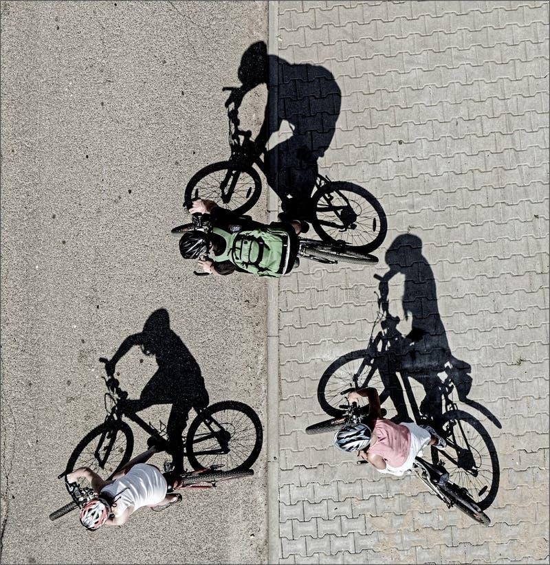 Três ciclistas imagens de stock