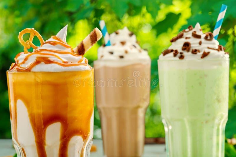 Três cocktail diferentes do milk shake foto de stock royalty free