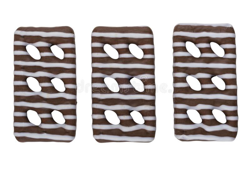 Três cookies vitrificadas listradas isoladas no fundo branco imagens de stock royalty free
