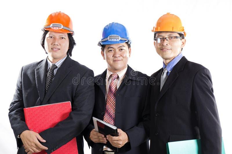 Três coordenadores prepararam o workong foto de stock