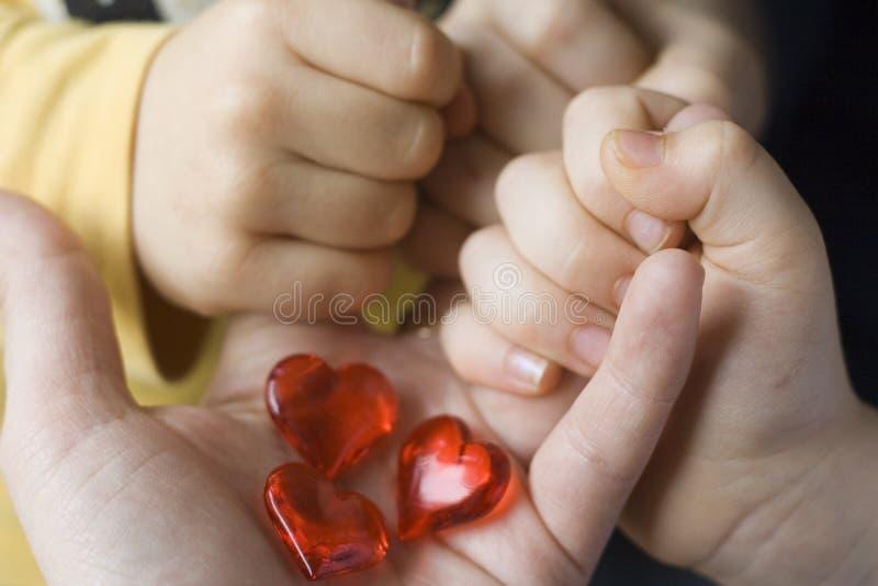 Três corações pequenos três crianças foto de stock royalty free