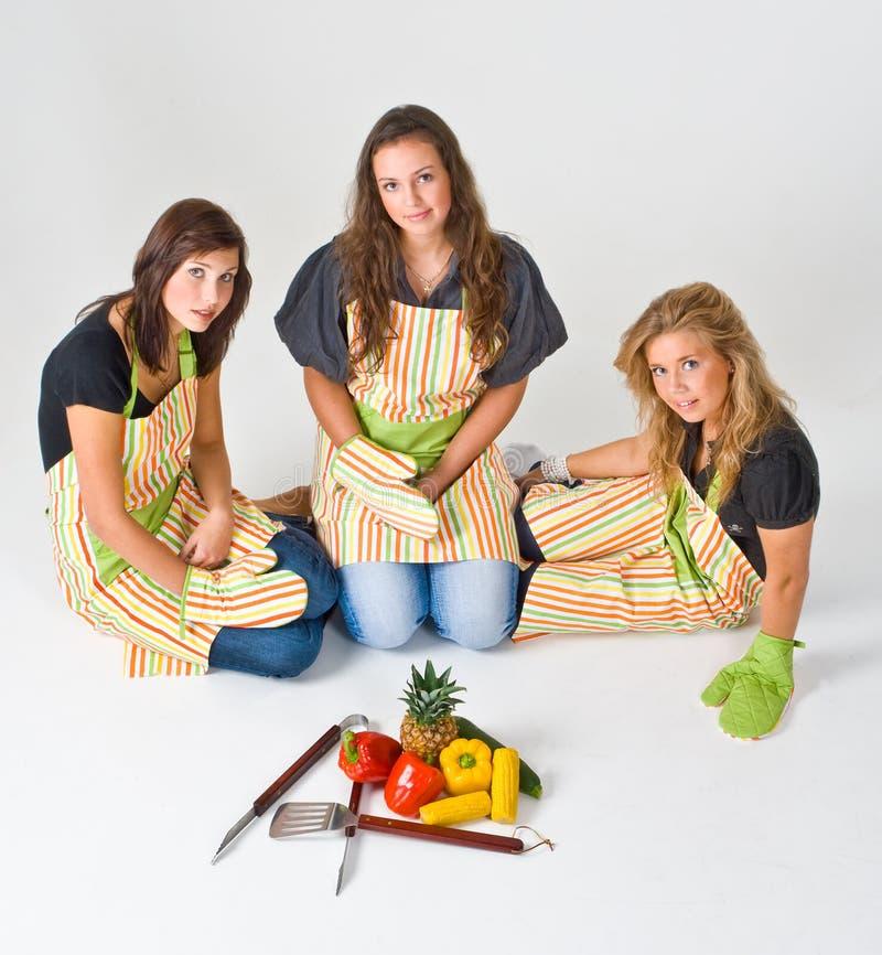 Três cozinheiros adolescentes foto de stock royalty free