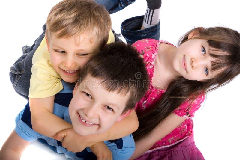 Três crianças felizes imagens de stock royalty free