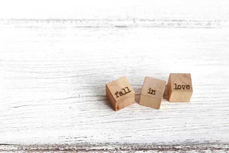 Três cubos de madeira com palavras fotos de stock royalty free