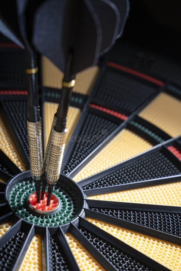Três dardos no bullseye do alvo fotografia de stock royalty free