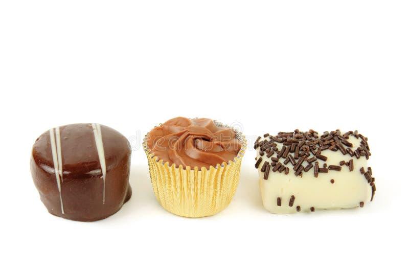 Três doces do chocolate fotografia de stock