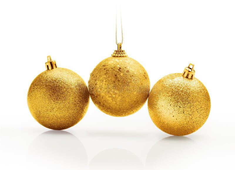 Três dourados e bolas efervescentes do Natal fotografia de stock royalty free