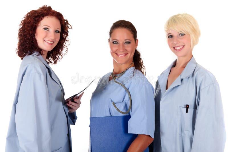 Três doutores fêmeas atrativos fotos de stock royalty free