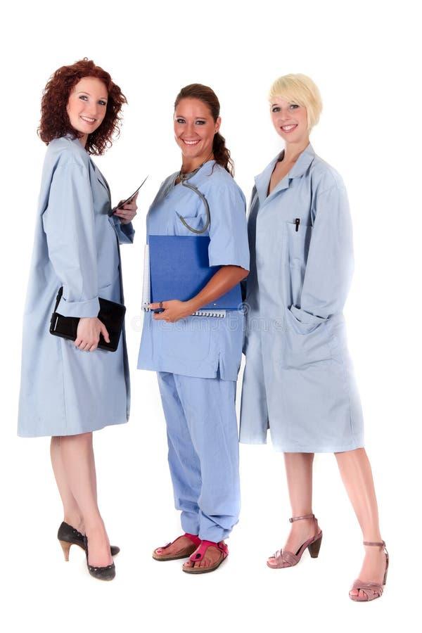 Três doutores fêmeas atrativos fotografia de stock royalty free