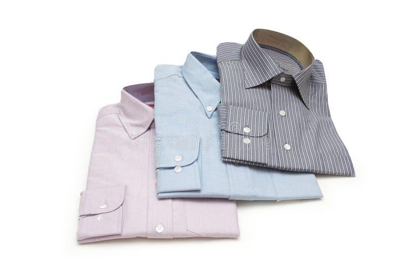 Três embalaram as camisas isoladas fotos de stock royalty free