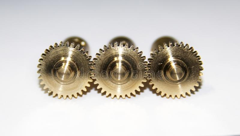 Três engrenagens douradas foto de stock royalty free
