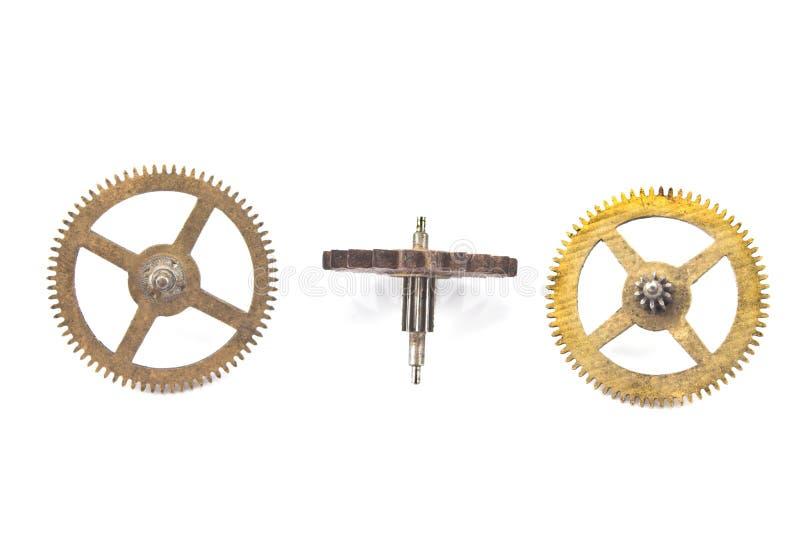 Três engrenagens velhas das rodas denteadas foto de stock