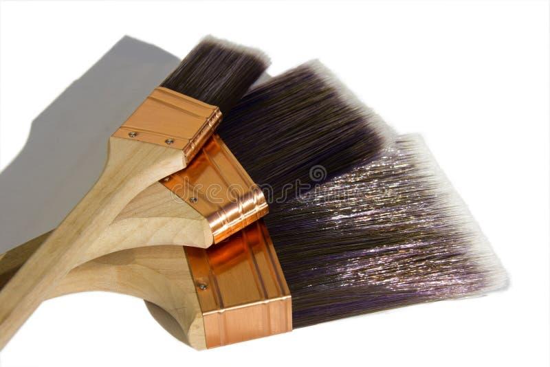 Três escovas de pintura sintéticas foto de stock