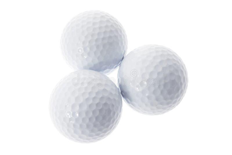 Três esferas de golfe fotos de stock