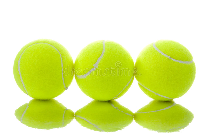 Três esferas de tênis amarelas fotos de stock royalty free