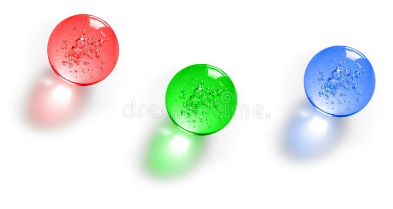 Três esferas de vidro da cor imagem de stock royalty free