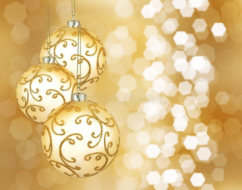Três esferas douradas bonitas do Natal imagem de stock royalty free