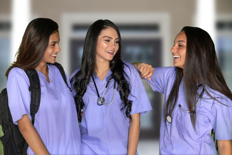 Três estudantes de nutrição imagens de stock