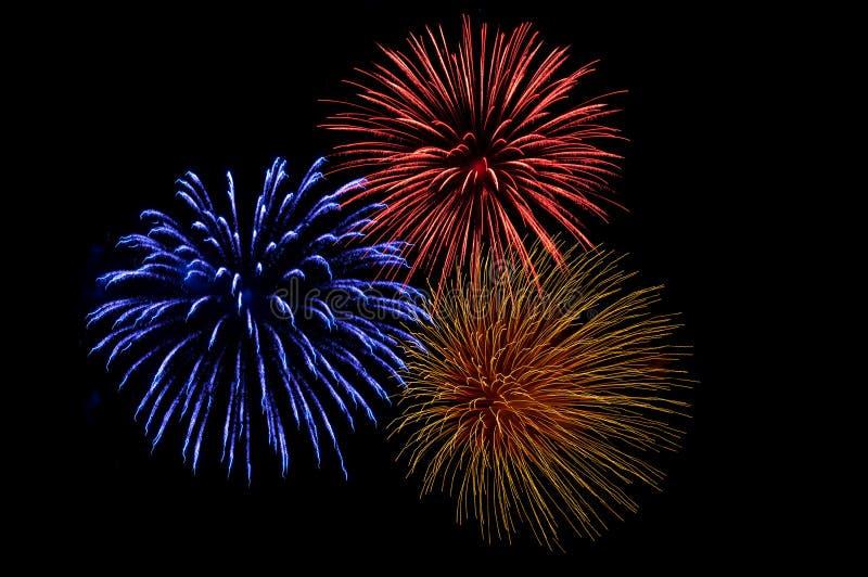 Três explosões coloridas do fogo-de-artifício imagem de stock