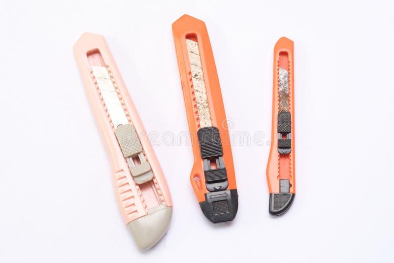 Três facas de serviço público de tamanhos diferentes imagens de stock royalty free