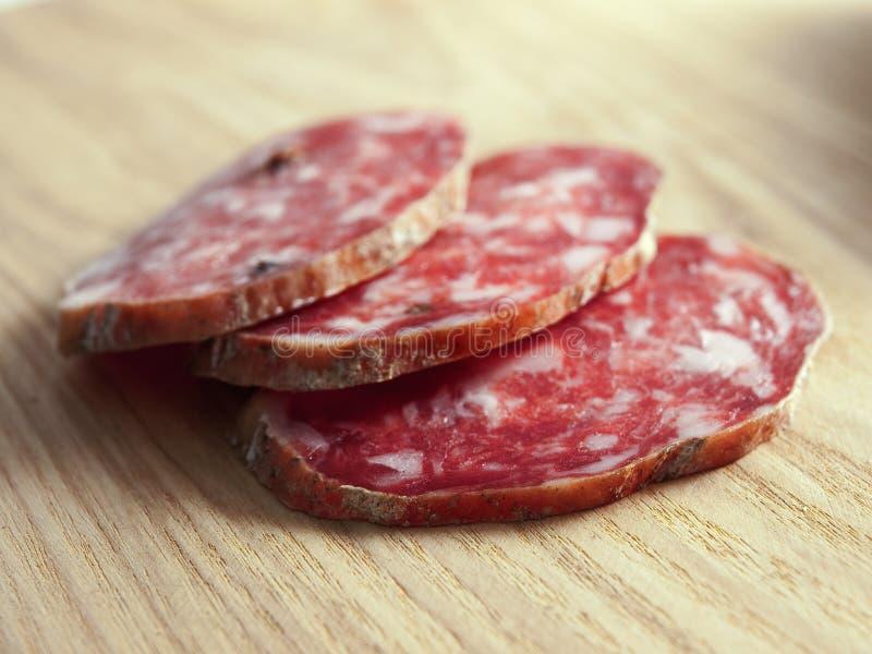 Três fatias do salami imagens de stock