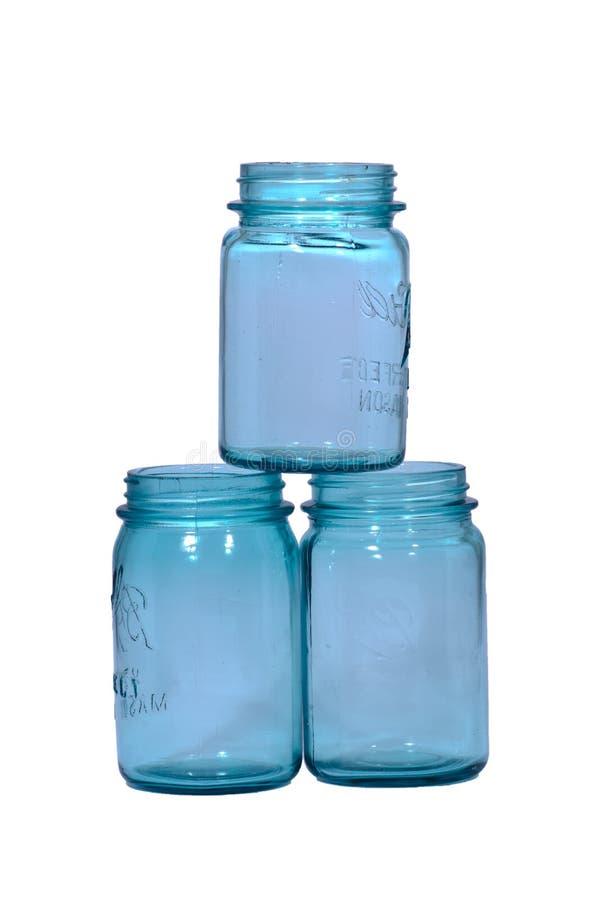 Três frascos de colocação em latas azuis imagem de stock royalty free