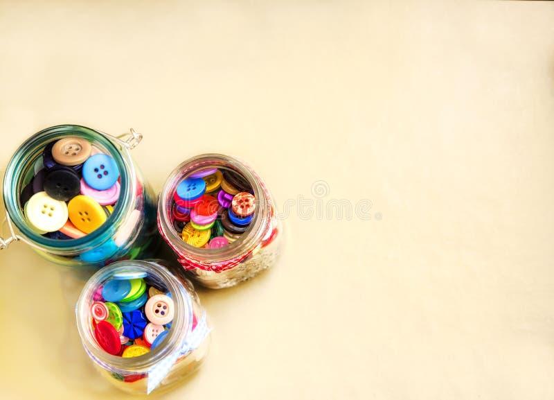 Três frascos dos botões imagem de stock