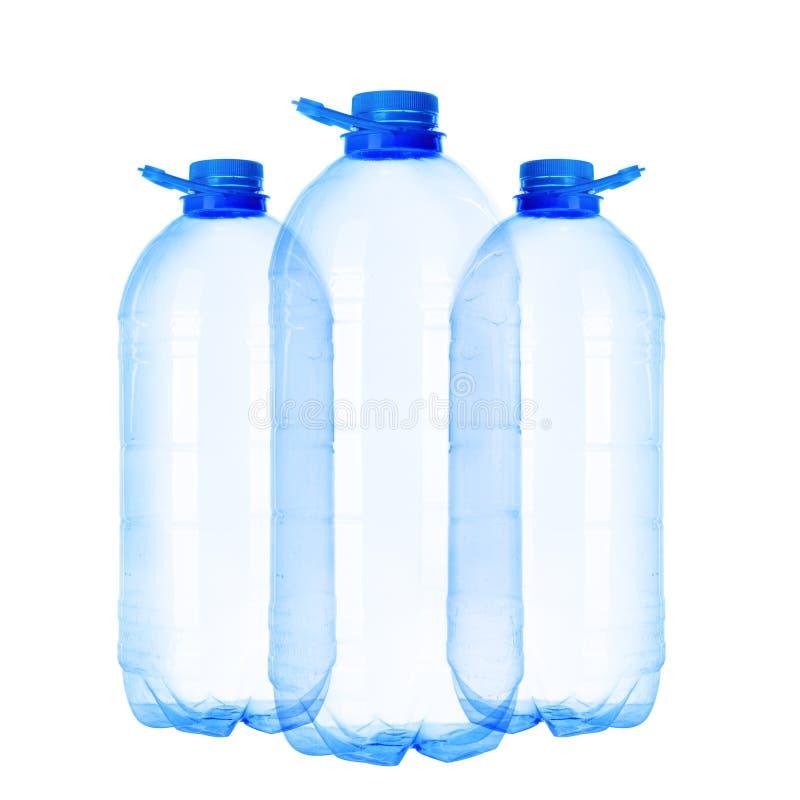 Três garrafas de cinco-litro fotos de stock