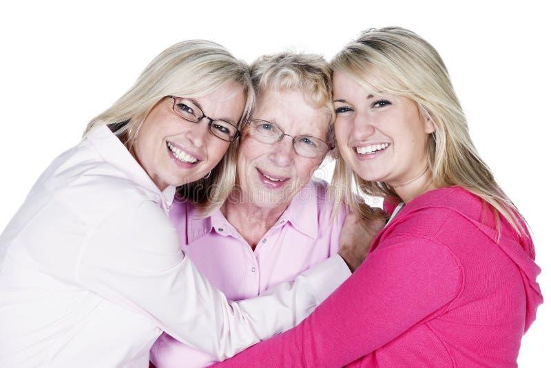 Três gerações de mulheres louras isoladas no branco fotos de stock
