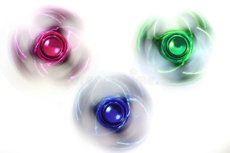 Três giradores da inquietação imagem de stock