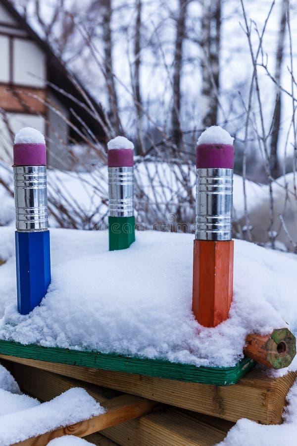 Três grandes lápis na neve imagem de stock royalty free