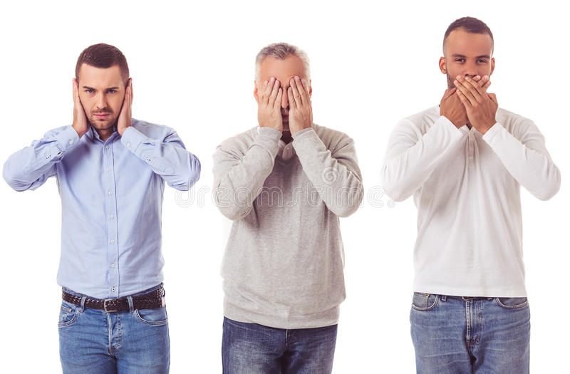 Três homens de negócios consideráveis foto de stock royalty free
