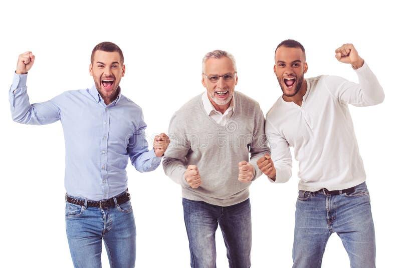 Três homens de negócios consideráveis fotos de stock