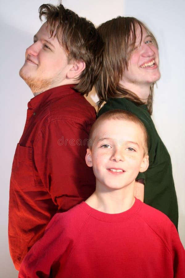 Três irmãos felizes fotografia de stock royalty free