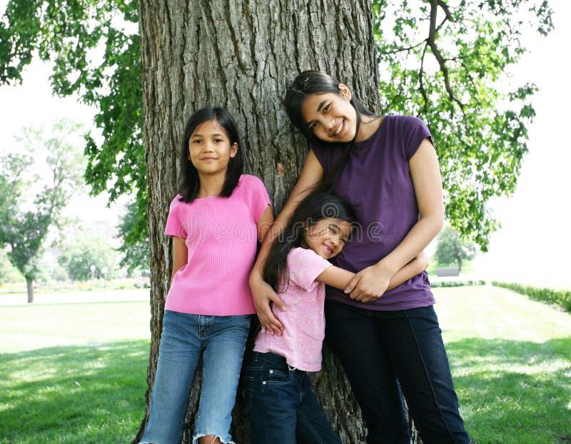 Três irmãs imagem de stock royalty free