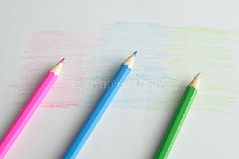 Três lápis colorindo foto de stock