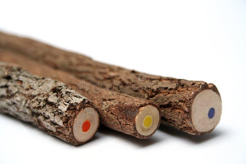 Três lápis incomuns com um núcleo multi-coloured foto de stock