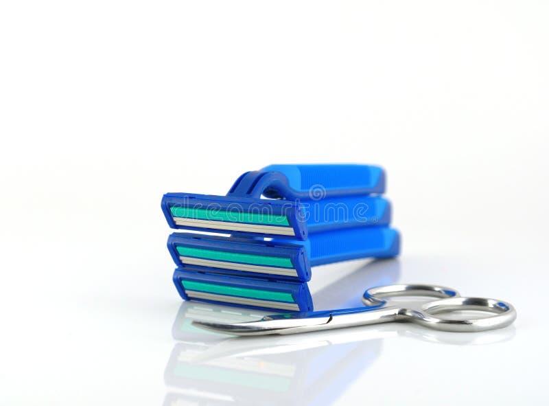 Três lâminas e tesouras azuis fotografia de stock