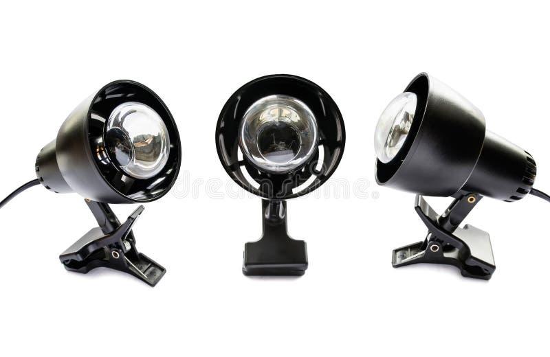 Três lâmpadas de grampo pretas imagem de stock