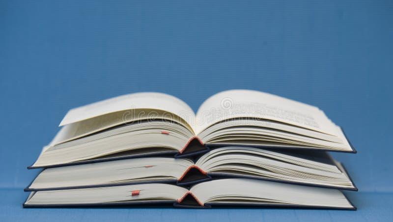 Três livros abertos fotografia de stock royalty free